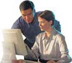 Man and woman looking at computer monitor