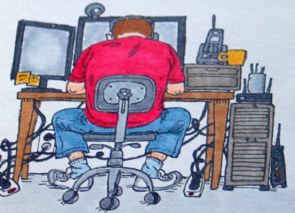 Man at computer back side